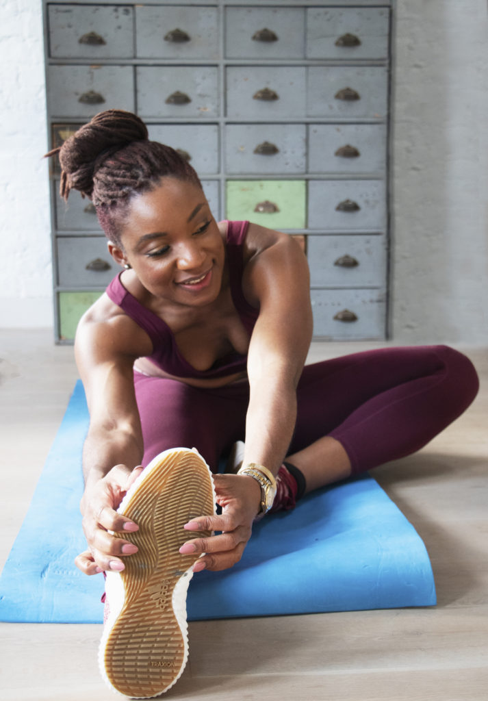LBB Founder, Nnenna stretching on a mat